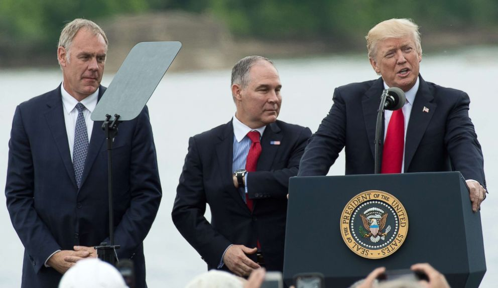 PHOTO: President Donald Trump, speaks while Secretary of the Interior Ryan Zinke, left, and EPA Administrator Scott Pruitt, stand at his side in Cincinnati, Ohio, June 7, 2017.