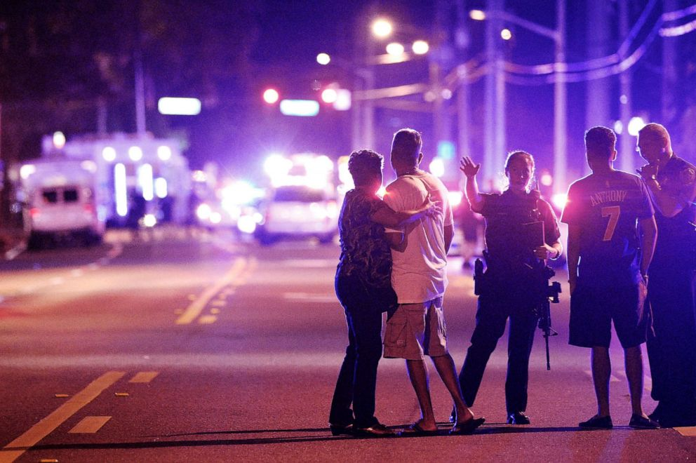 PHOTO: An Orlando Police officer directs family members away from a mass shooting at the Pulse nightclub in Orlando, Fla., that left 49 people dead, June 12, 2016.
