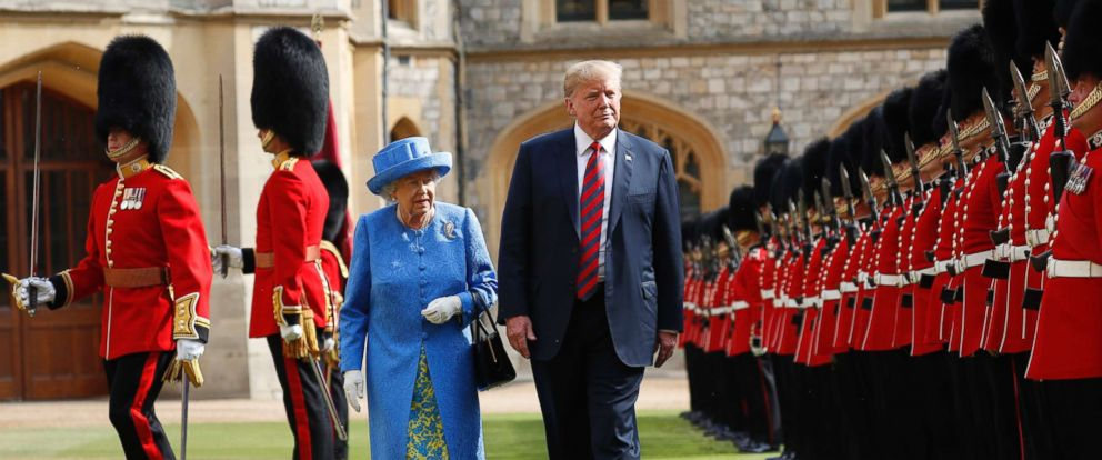 PHOTO: U.S. President Donald Trump with Queen Elizabeth II, inspects the Guard of Honour at Windsor Castle in Windsor, England.