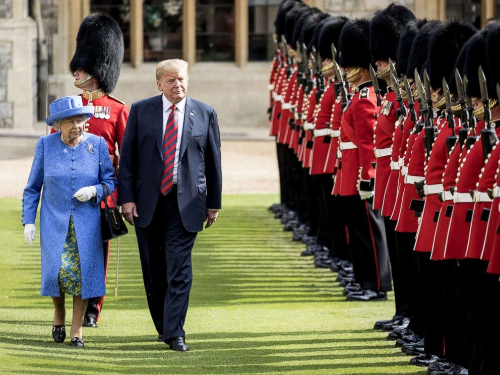 PHOTO: Britains Queen Elizabeth II and President Donald Trump inspect a Guard of Honor, formed of the Coldstream Guards at Windsor Castle, July 13, 2018, in Windsor, England.