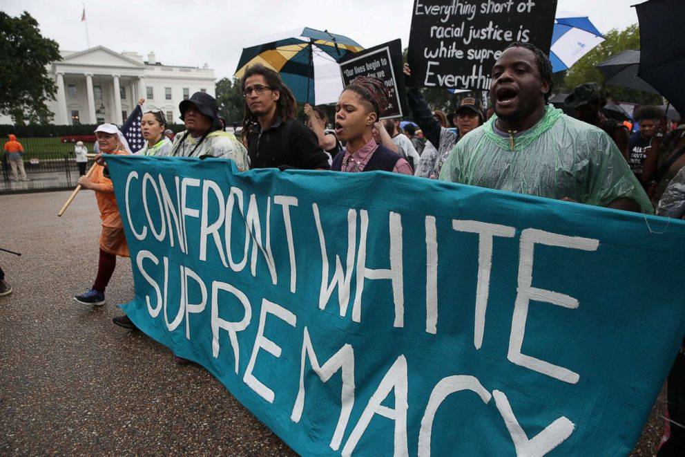 PHOTO: Marchers pass the White House after completing the 118-mile long journey from Charlottesville to Washington, D.C., calling for the dismantling of white supremacy, Sept. 6, 2017.