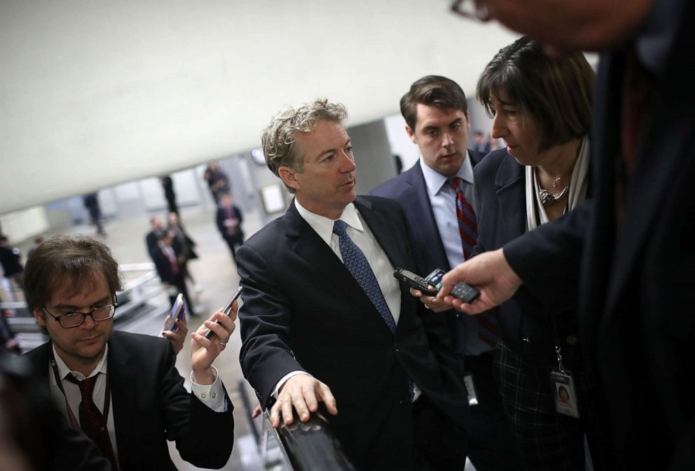 PHOTO: Sen. Rand Paul (R-KY) speaks with reporters on his way to a vote on the floor of the Senate at the Capitol, Feb. 8, 2018.