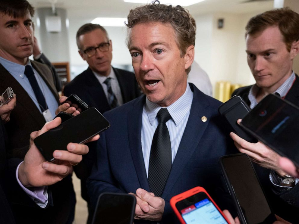 PHOTO: Sen. Rand Paul responds to reporters at the Capitol after he threatened to reveal the name of the Ukraine whistleblower, in Washington, Nov. 6, 2019.