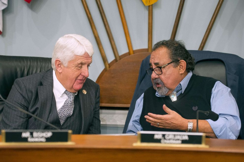 House Natural Resources Committee Chairman Raul Grijalva, right, talks with Ranking Member Rob Bishop during the committee's hearing on climate change on Capitol Hill in Washington, Feb. 6, 2019.