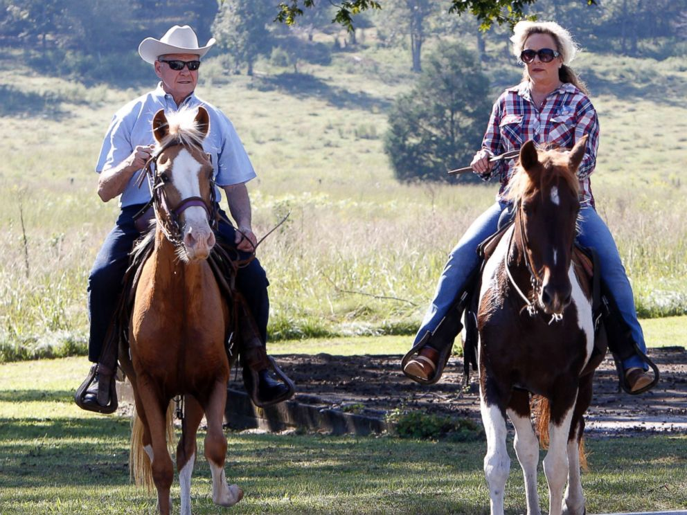 PHOTO: Alabama Republican Senate candidate Roy Moore on Sassy and wife Kayla on Sundance ride their horses to the Gallant Fire Hall to vote in todays GOP runoff election, Sept. 26, 2017, in Gallant, Ala.