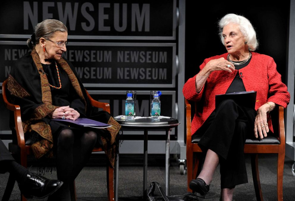 FILE PHOTO: The first female supreme court justice, Sandra Day O'Connor (R), speaks as fellow Justice Ruth Bader Ginsburg listens during a forum at the Newseum, in Washington, April 11, 2012.
