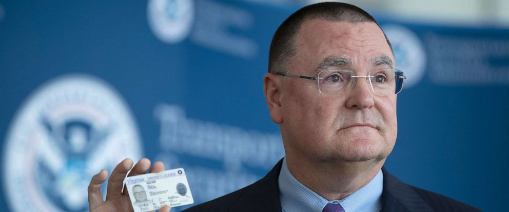 """PHOTO: Chief Executive Officer of the American Association of Airport Executives, Todd Hauptli, shows his """"Real ID"""" compliant drivers license during a news conference at Ronald Reagan Washington National Airport, in Washington, Oct. 1, 2019."""