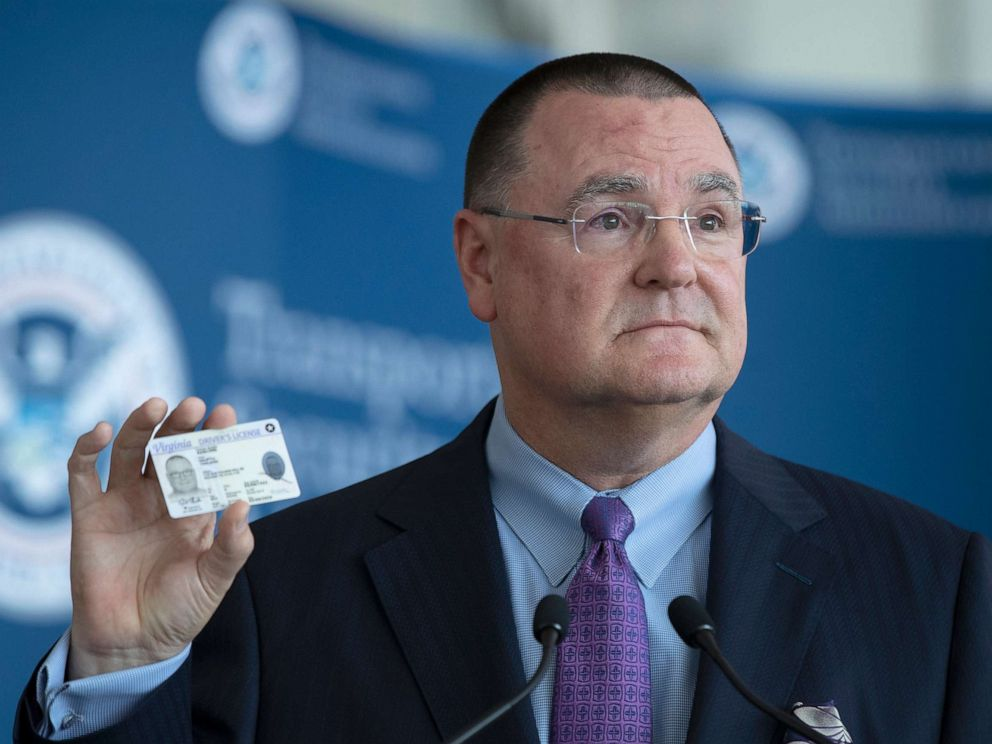 PHOTO: Chief Executive Officer of the American Association of Airport Executives, Todd Hauptli, shows his Real ID compliant drivers license during a news conference at Ronald Reagan Washington National Airport, in Washington, Oct. 1, 2019.