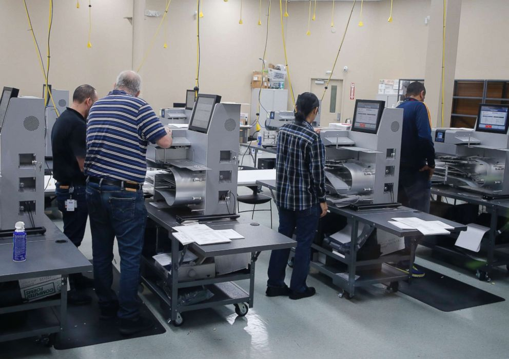 PHOTO: Election officials work at counting machines as they are calibrated before a recount at the Broward County Supervisor of Elections Office, Nov. 11, 2018, in Lauderhill, Fla.