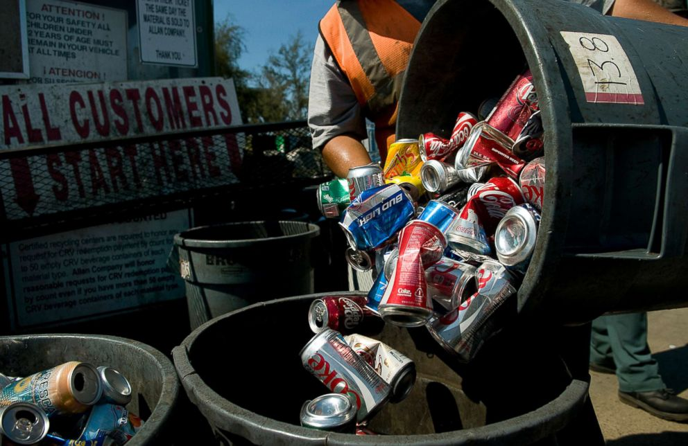 PHOTO: A worker consolidates metal cans at the Miramar Recycling facility in San Diego, Calif., Aug. 13, 2012.