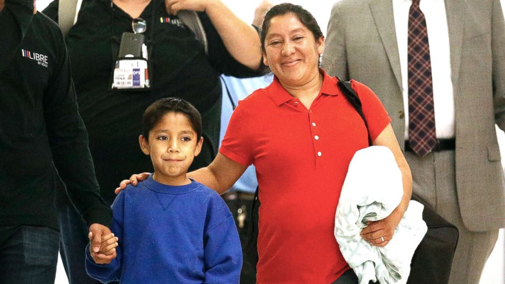 Darwin Micheal Mejia, left, and his mother Beata Mariana de Jesus Mejia-Mejia are escorted to a news conference after their reunion at Baltimore-Washington International Thurgood Marshall Airport on June 22, 2018, in Linthicum, Md.