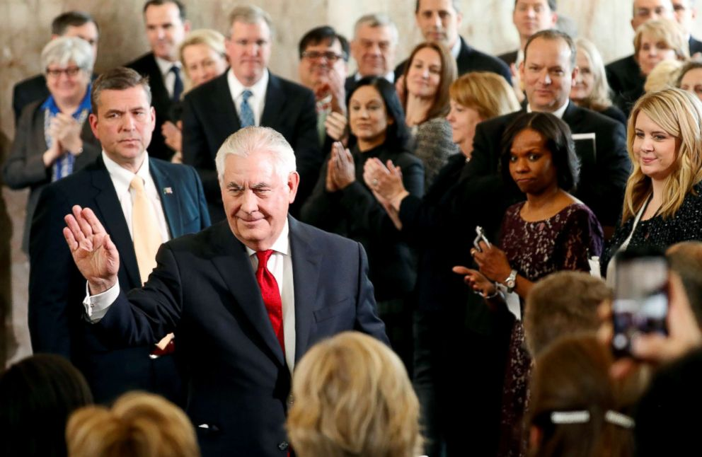 PHOTO: Outgoing U.S. Secretary of State Rex Tillerson waves to applauding State Department workers as he leaves the State Department for the last time in Washington, March 22, 2018.