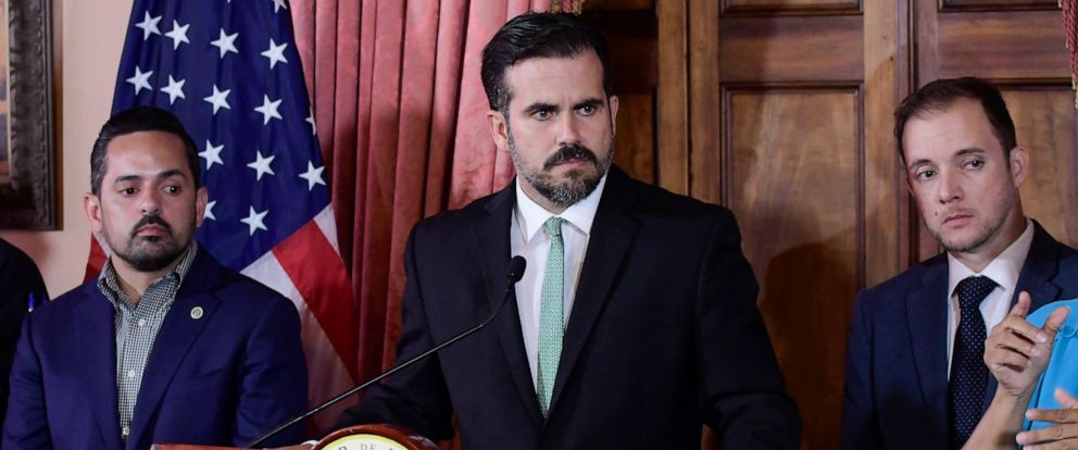 PHOTO: In this July 16, 2019 file photo, Puerto Rico Gov. Ricardo Rossello, accompanied by his chief of staff Ricardo Llerandi, right, attends a press conference in La Fortalezas Tea Room, in San Juan, Puerto Rico.