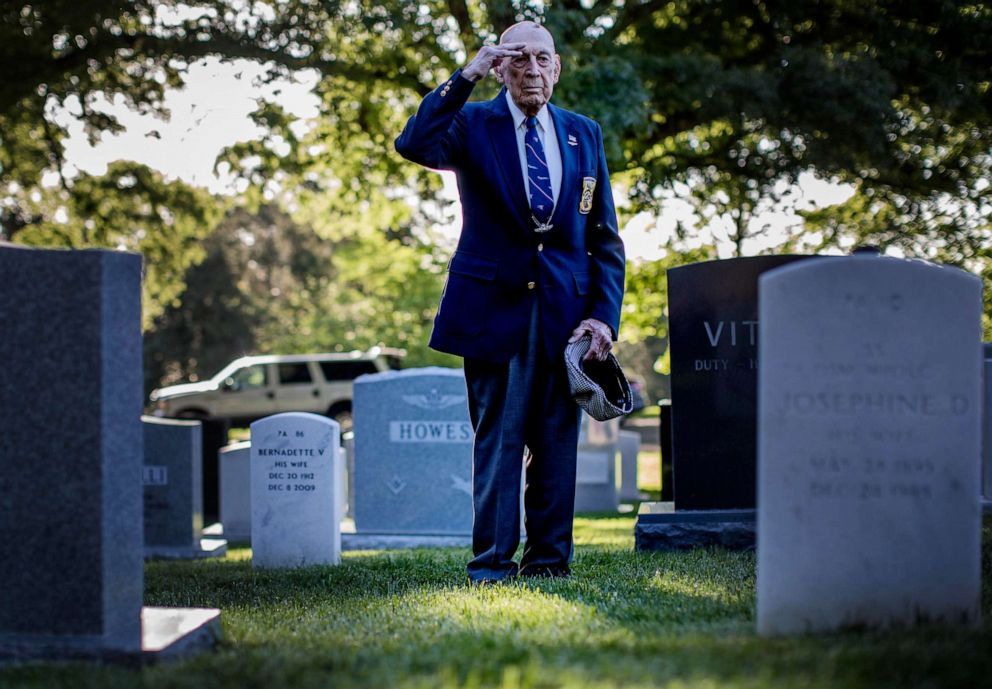 PHOTO: Lt. Col. Richard Cole, a member of the Doolittle Raiders who bombed Japan, visits the grave site of Lt. Col. Jimmy Doolittle, who he flew with on the bombing mission, buried at Arlington National Cemetery in Virginia, May 23, 2014.