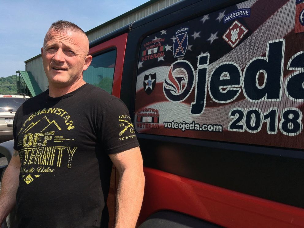 PHOTO: In this Tuesday, May 15, 2018 photo, Richard Ojeda talks outside his campaign headquarters in Logan, W.Va. Ojeda is decorated with military medals and 26 tattoos and can bench presses 300 pounds.