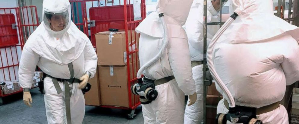 PHOTO: Defense Department personnel, wearing protective suits, screen mail as it arrives at a facility near the Pentagon, Oct. 2, 2018. Police arrested a suspect after suspicious packages containing castor seeds.