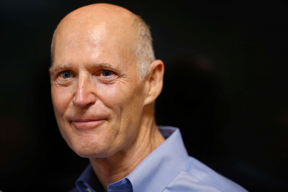 Florida Gov. Rick Scott looks on after a news conference at the Florida Department of Transportation (FDOT) District Four Office, Aug. 22, 2018, in Fort Lauderdale, Fla.