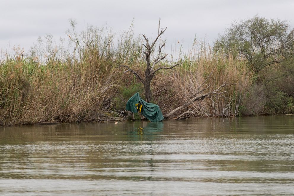 PHOTO: A deflated raft used by human traffickers is tangled in a tree along the banks of the Rio Grande on Jan. 16, 2019, in Mission, Texas.