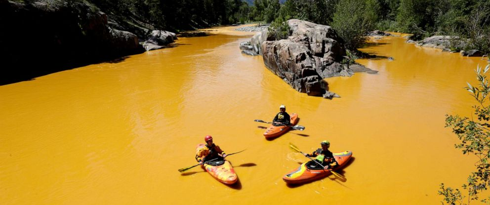 PHOTO: In this Aug. 6, 2015, file photo, people kayak in the Animas River near Durango, Colo., in water colored with millions of gallons of mine waste into Cement Creek, which flows into the Animas River.