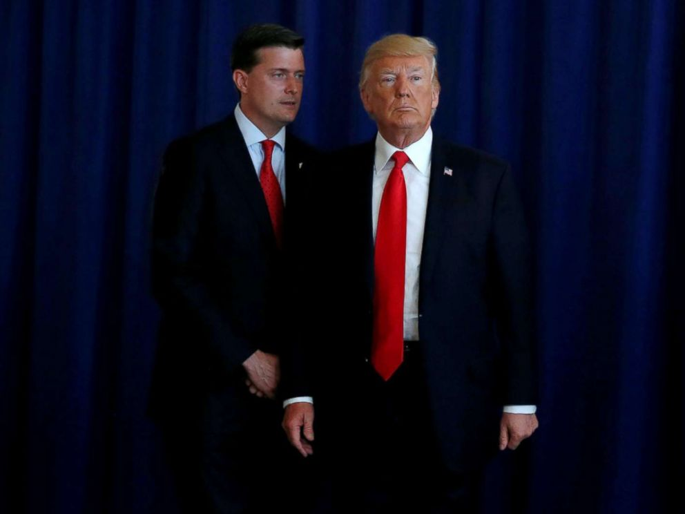 PHOTO: White House Staff Secretary Rob Porter speaks to President Donald Trump at his golf estate in Bedminster, N.J., Aug. 12, 2017.