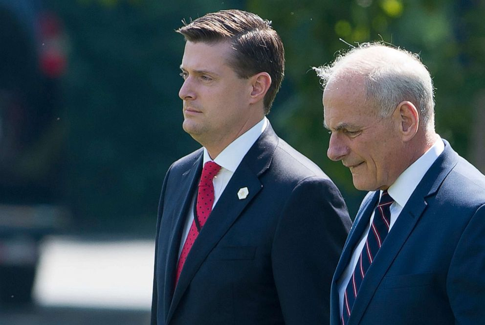 PHOTO: In this August 4, 2017, file photo, White House Chief of Staff John Kelly (R) and White House Staff Secretary Rob Porter (L) walk to Marine One prior to departure from the South Lawn of the White House in Washington, D.C.