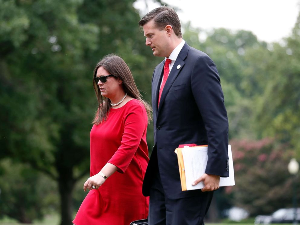 PHOTO: White House press secretary Sarah Huckabee Sanders, left, and White House Staff Secretary Rob Porter, arrive on the South Lawn of the White House, Aug. 14, 2017, in Washington.