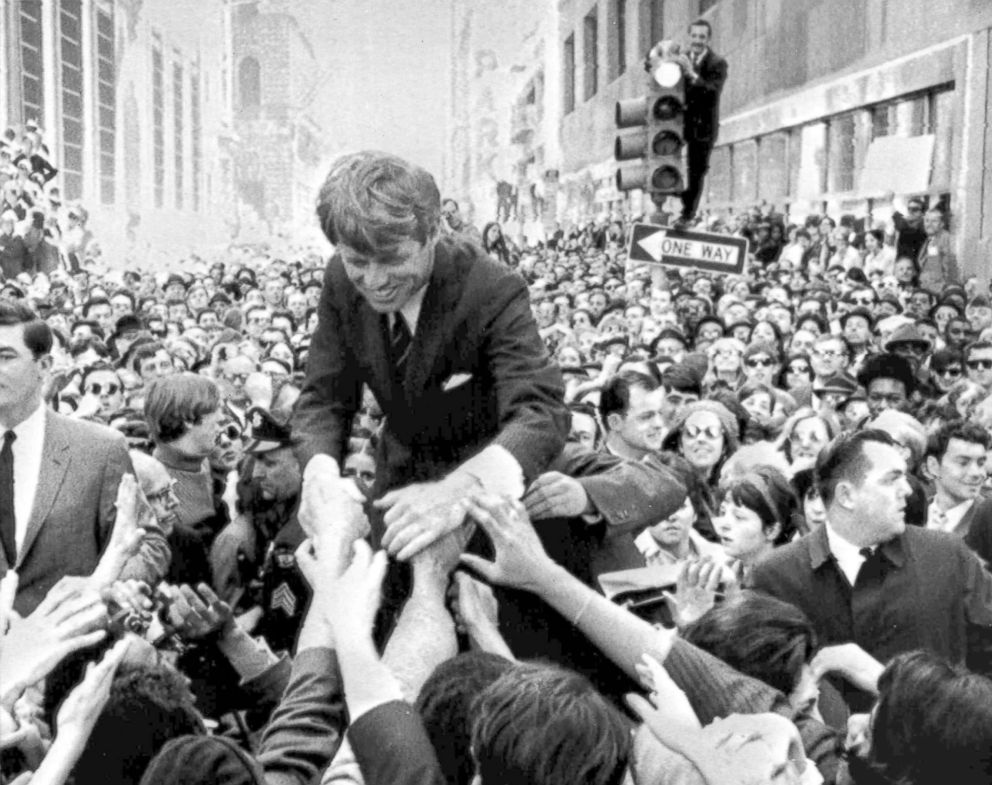 PHOTO: Sen. Robert F. Kennedy shakes hands with people in a crowd while campaigning for the Democratic partys presidential nomination on a street corner in Philadelphia, April 2, 1968.