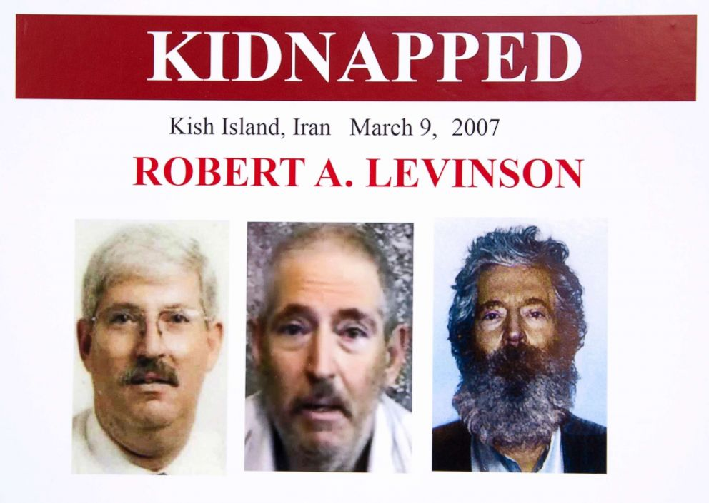 An FBI poster showing a composite image of retired FBI agent Robert Levinson, right, of how he would look like now after five years in captivity, and an image, center, taken from the video, released by his kidnappers, and a picture before he was kidnapped, left, displayed during a news conference in Washington, March 6, 2012.