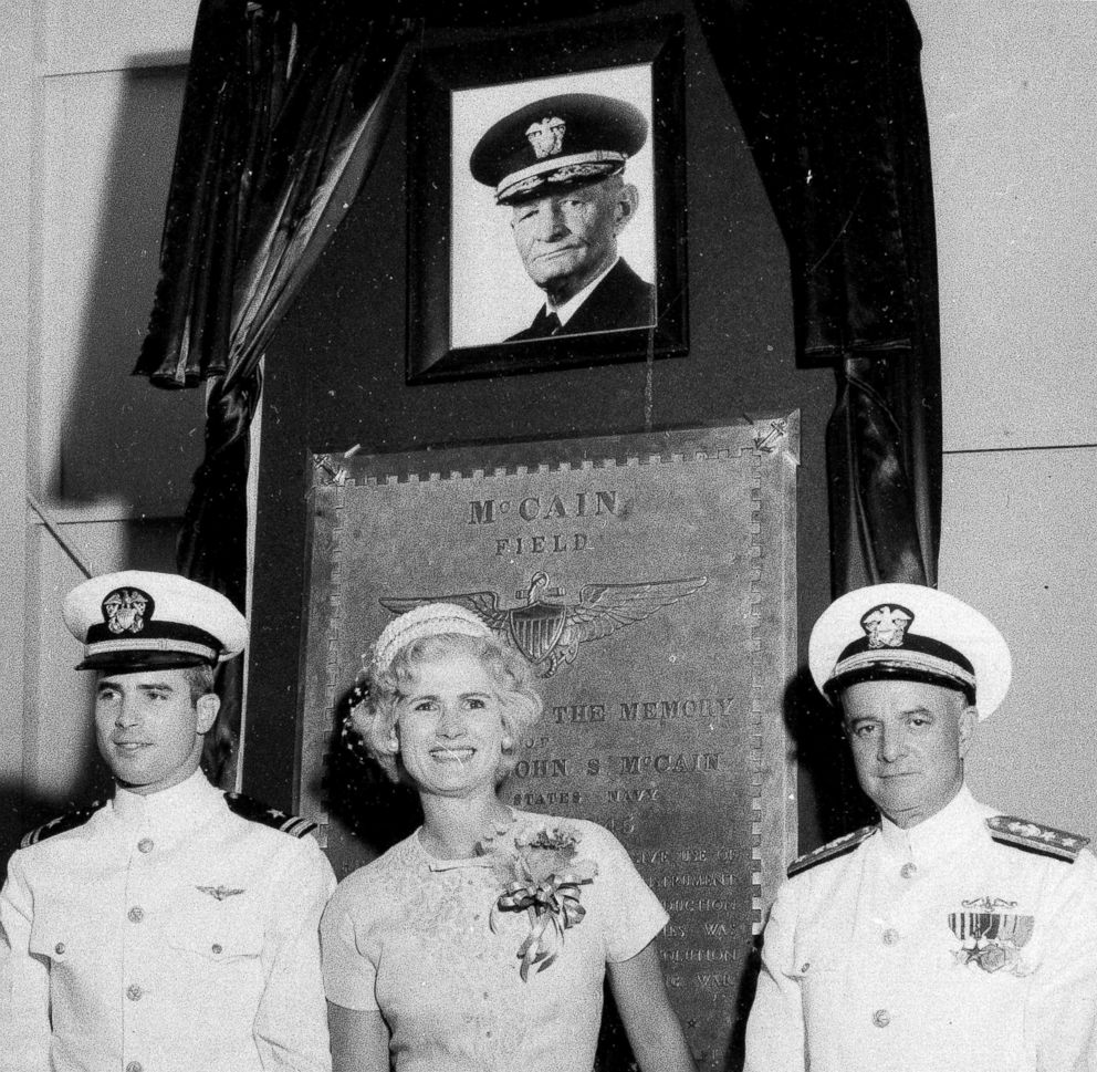 In this July 14, 1961, file photo, U.S. Navy Lt. John S. McCain III, left, and his parents, Rear Adm. John S. McCain Jr., right, and Roberta Wright McCain stand in front of a plaque with an image of his grandfather, Adm. John S. McCain, as the Naval Air Station Meridian McCain Field is commissioned and named in honor of Adm. McCain in Meridian, Miss.