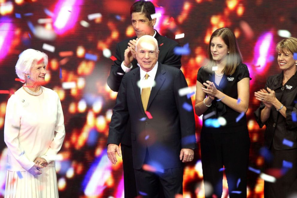 Confetti falls around Senator John McCain of Arizona, center, seen with his mother Roberta, left, and other members of his family, on day four of the Republican National Convention in St. Paul, Minnesota, Sept. 4, 2008.