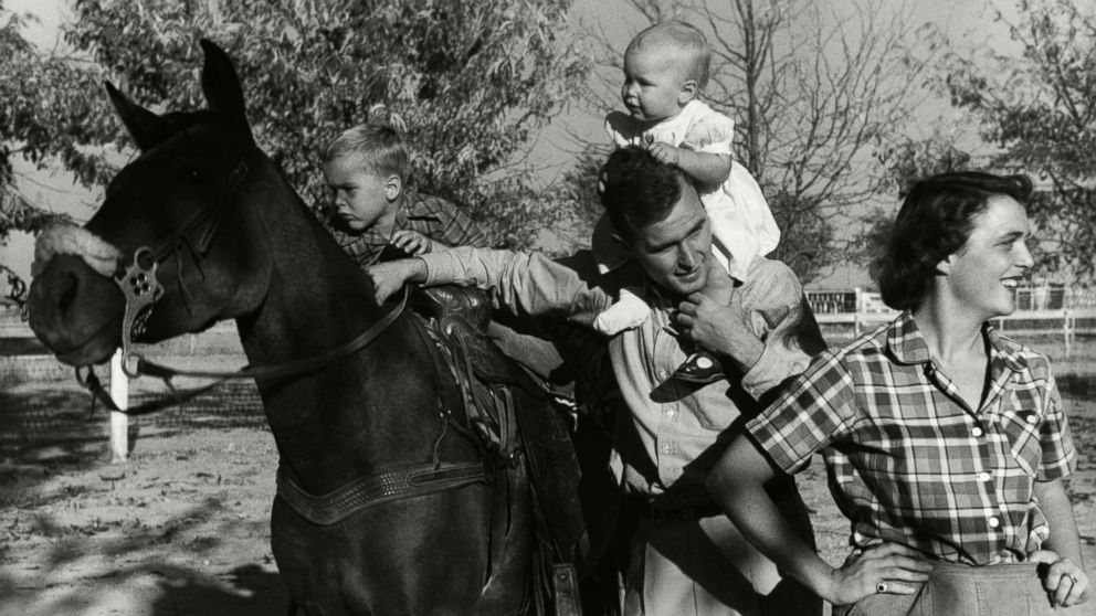 George H. W. Bush with his wife, Barbara, with  their children Pauline (Robin) and George W. on a horse in the yard of their Midlands, Texas ranch, Dec. 11, 1950.