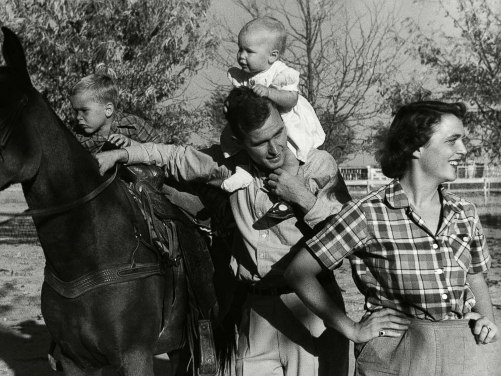 PHOTO: George H. W. Bush with his wife, Barbara, with their children Pauline (Robin) and George W. on a horse in the yard of their Midlands, Texas ranch, Dec. 11, 1950.