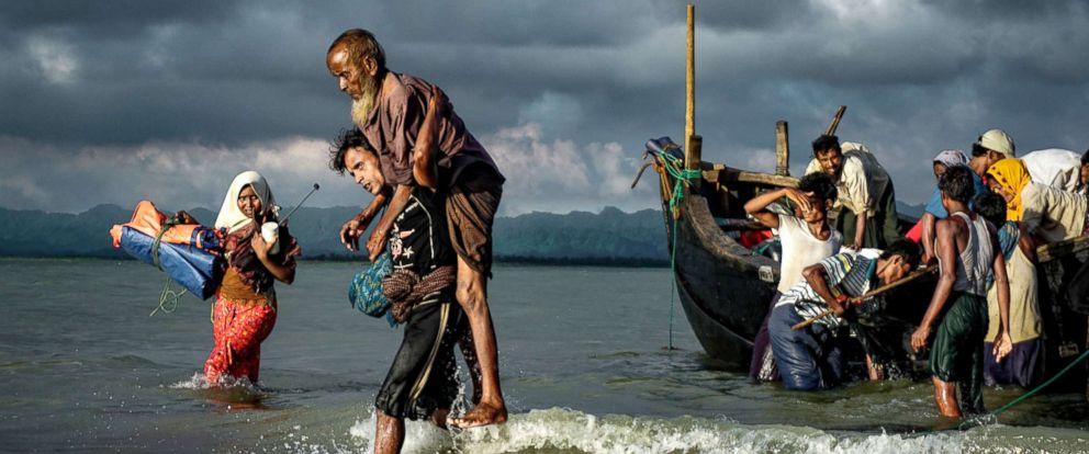 PHOTO: Rohingya Muslim refugees disembark from a boat on the Bangladeshi side of Naf river in Teknaf, Bangladesh, Sept. 13, 2017.