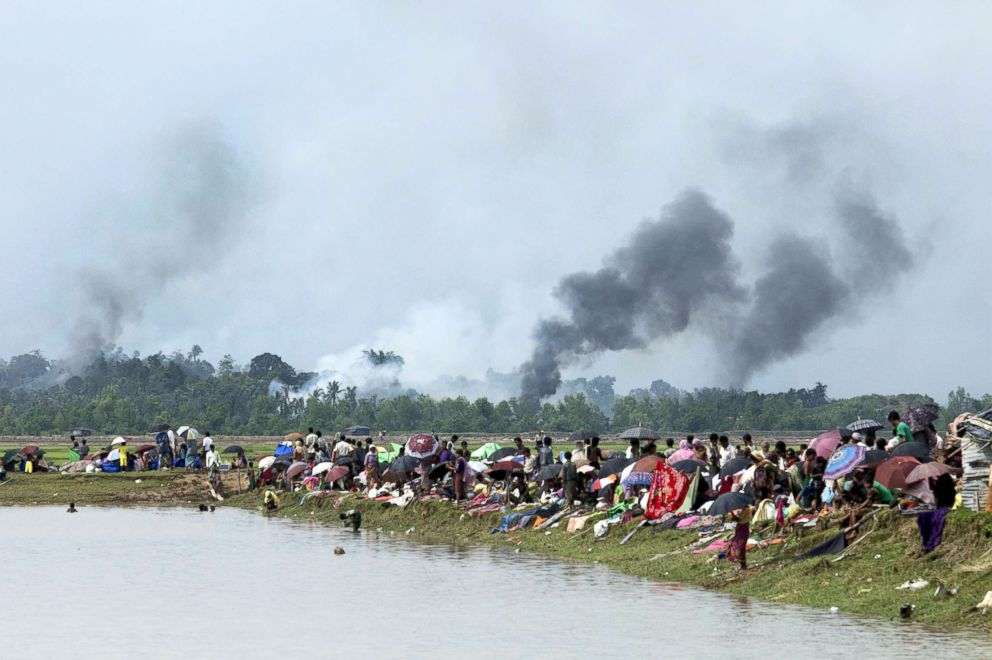 PHOTO: Smoke billows above what is believed to be a burning village in Myanmars Rakhine state as members of the Rohingya Muslim minority take shelter in a no-mans land between Bangladesh and Myanmar in Ukhia, Bangladesh, Sept. 4, 2017.