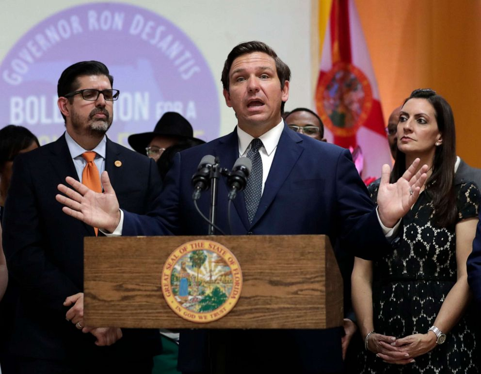 PHOTO: Florida Gov. Ron DeSantis, center, speaks during a bill signing ceremony at the William J. Kirlew Junior Academy in Miami Gardens, Fla., May 9, 2019.