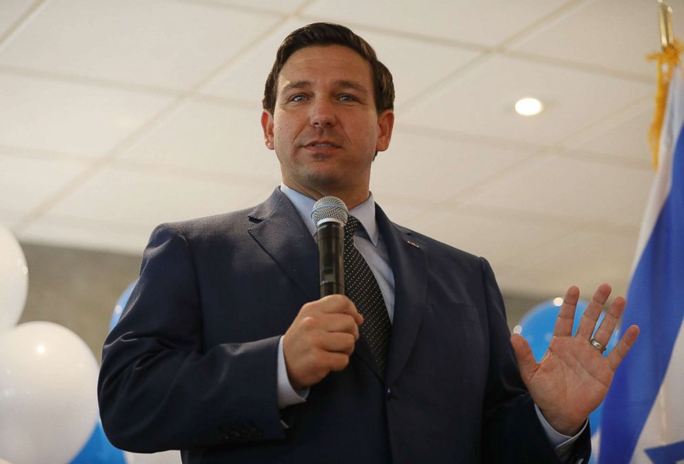 PHOTO: Republican gubernatorial candidate Ron DeSantis speaks during a campaign rally at Mos Bagels restaurant in Miami, Oct. 23, 2018.