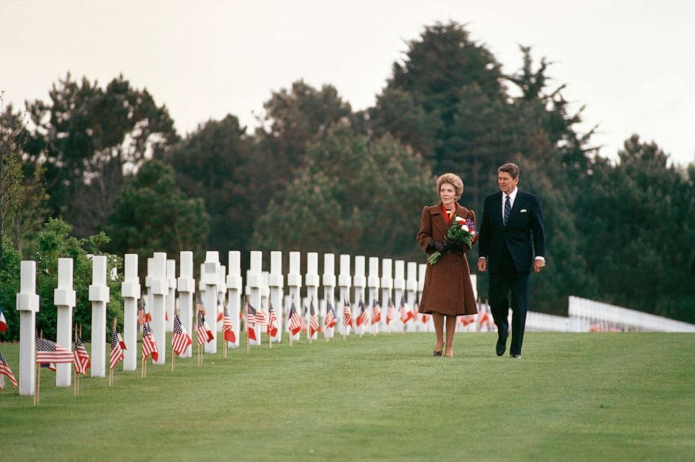 PHOTO: President Ronald Reagan and first lady Nancy Reagan walk among the crosses of the Normandy American Cemetery June 6, 1984 in Normandy, France.