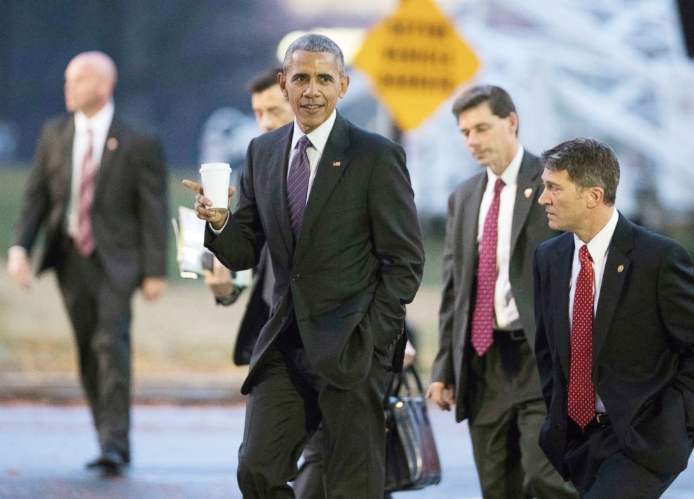 President Barack Obama walks with his physician Ronny Jackson, right, towards a waiting Marine One as he leaves Walter Reed National Military Medical Center in Bethesda, Md., after visiting wounded service members,, Nov. 29, 2016.