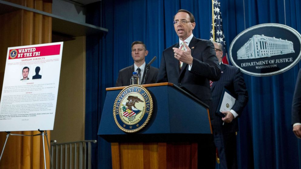 Deputy Attorney General Rod Rosenstein speaks during a news conference announcing the indictment against international computer hackers at the Department of Justice in Washington, Nov. 28, 2018.