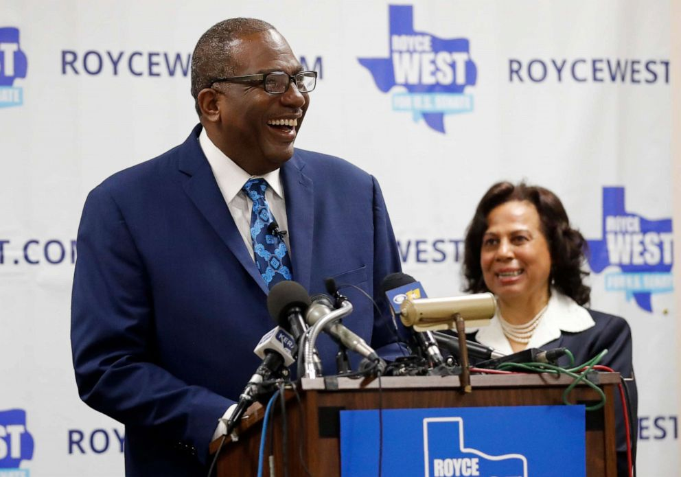 PHOTO: State Senator Royce West smiles as his wife Carol, right rear, looks on during a rally where West announced his bid to run for the US Senate in Dallas, Monday, July 22, 2019.