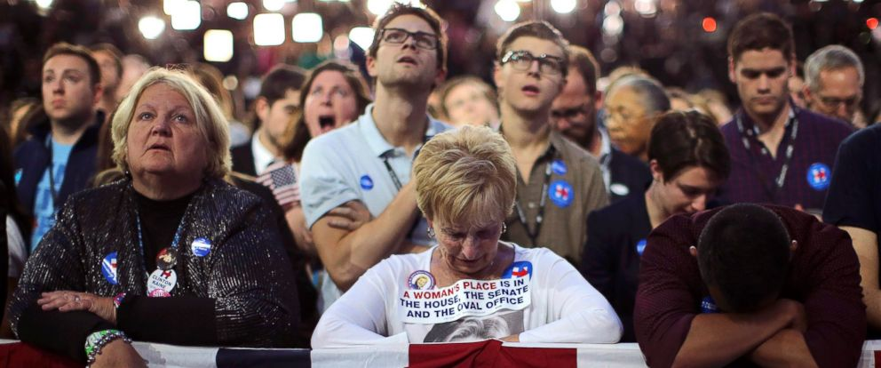 PHOTO: Supporters of Hillary Clinton watch and wait at her election night rally in New York, Nov. 8, 2016.