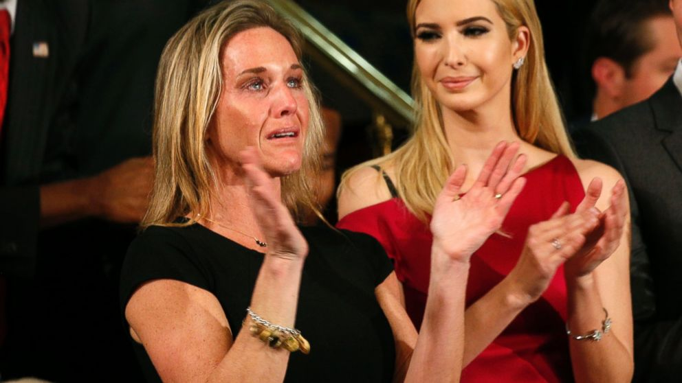 """Carryn Owens, widow of Senior Chief Petty Officer William """"Ryan"""" Owens, applauds after being mentioned by President Trump during his address to a joint session of the U.S. Congress on Feb. 28, 2017 in Washington, DC."""