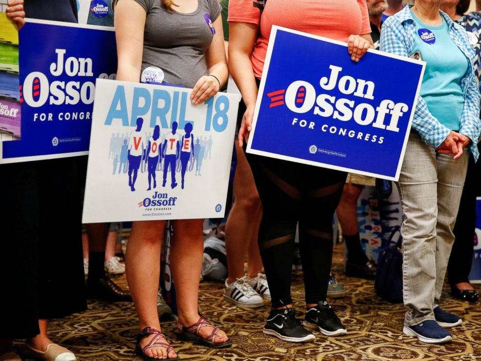 PHOTO: Supporters of Democratic candidate Jon Ossoff, running for Georgias 6th Congressional District, listen as he speaks during an election eve rally at Andretti Indoor Karting and Games in Roswell, Georgia, April 17, 2017.