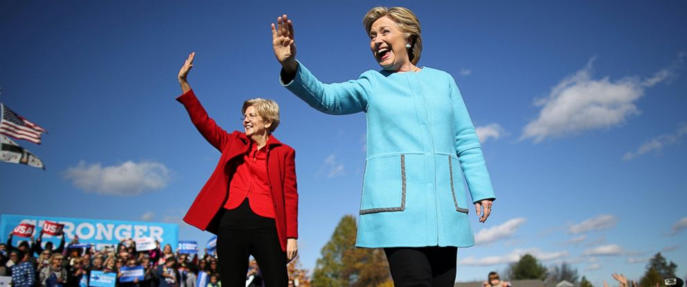 PHOTO: Hillary Clinton, right, waves as she arrives to a campaign event accompanied by U.S. Senator Elizabeth Warren (D-MA), left, at Alumni Hall Courtyard, Saint Anselm College in Manchester, New Hampshire, Oct. 24, 2016.