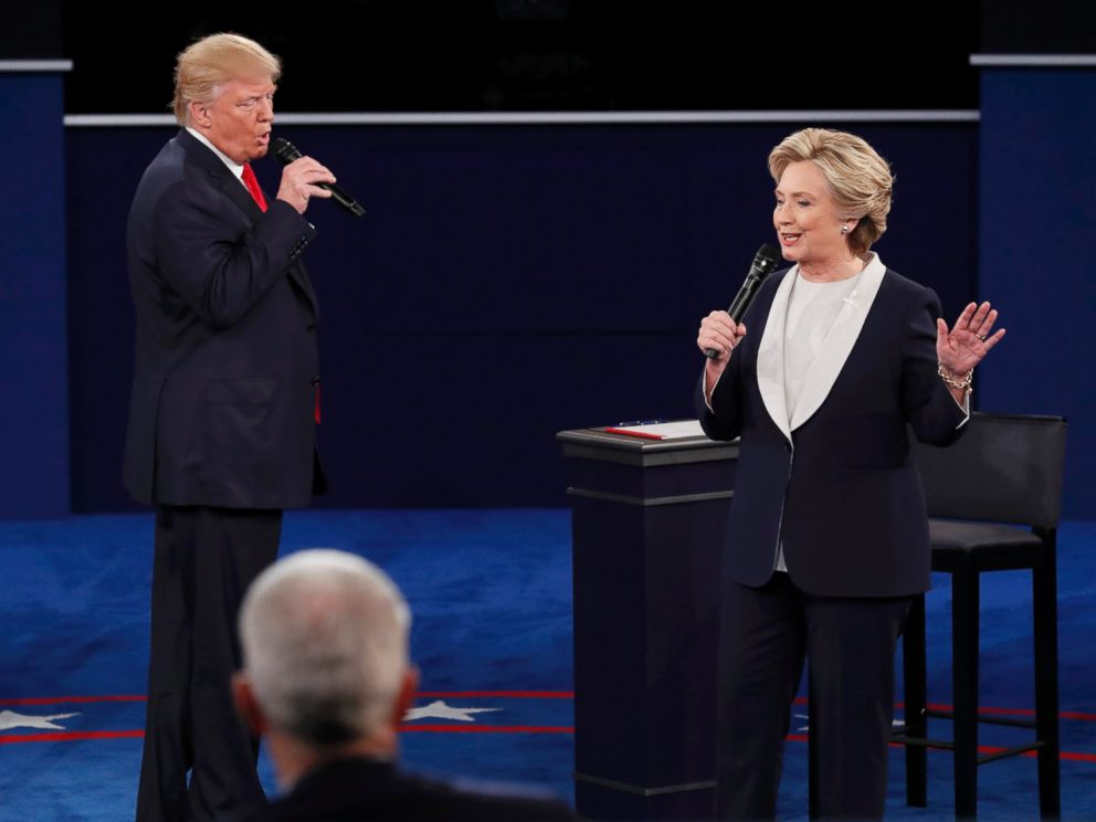PHOTO: Donald Trump and Hillary Clinton speak during their presidential town hall debate at Washington University in St. Louis, Missouri, Oct. 9, 2016.