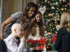 PHOTO: First lady Michelle Obama meets with the children of U.S. military service members at the unveiling of the Christmas decorations at the White House in Washington, Dec. 4, 2013.