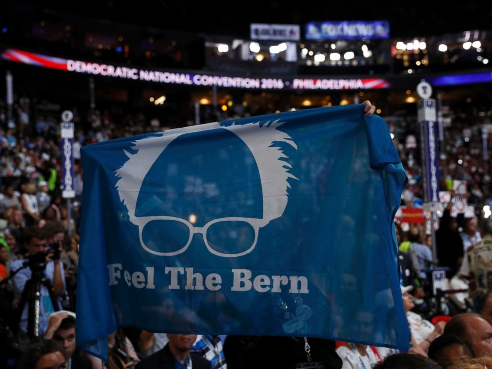 PHOTO: Supporters of Senator Bernie Sanders hold up a Feel the Bern banner as they protest on the floor during the first day of the Democratic National Convention in Philadelphia, July 25, 2016.