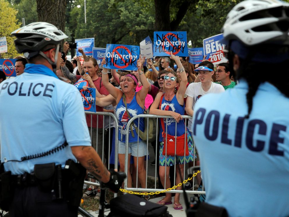 PHOTO: Bernie Sanders supporters yell across a police line during a protest at the Democratic National Convention in Philadelphia, July 25, 2016.