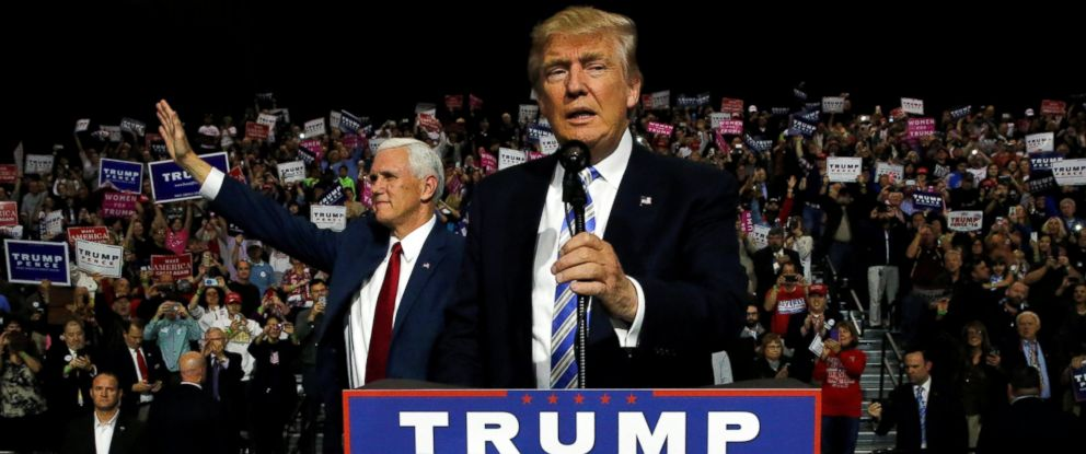 PHOTO: Donald Trump (R) and vice presidential candidate Mike Pence (L) hold a campaign rally in Cleveland, Ohio, Oct. 22, 2016.