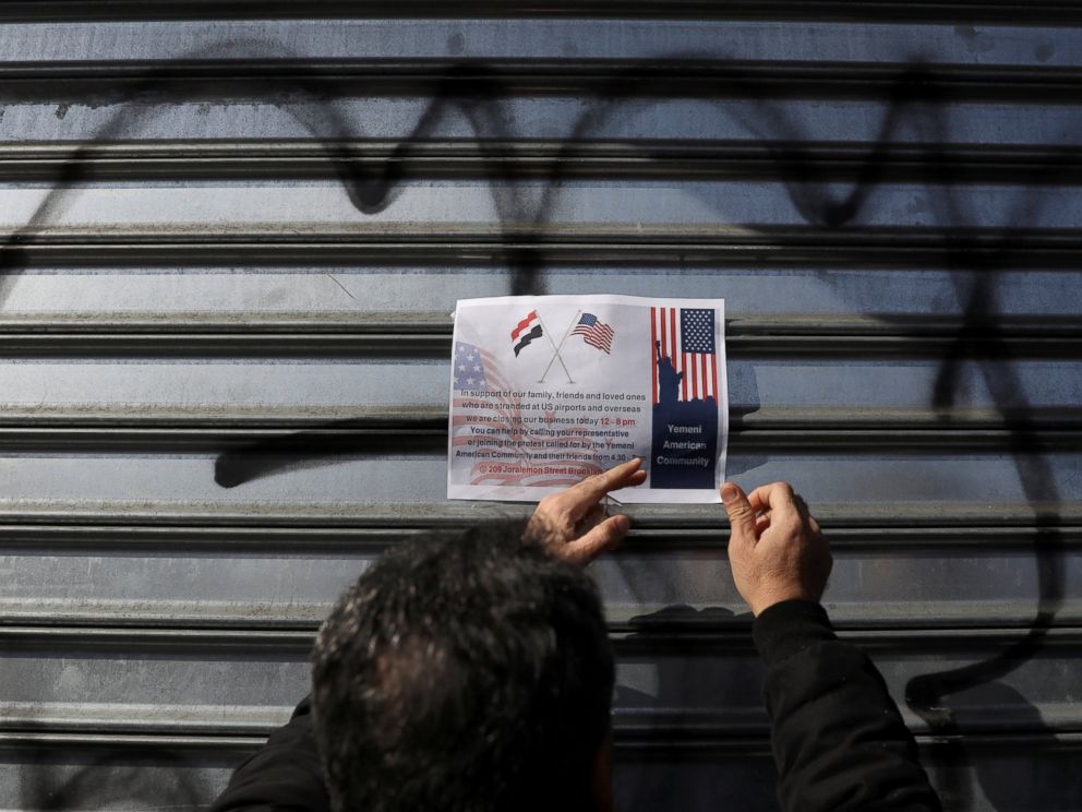 PHOTO: A worker posts a sign on a security gate after closing the doors to the Garden Deli in Manhattan as part of a citywide protest by Yemeni American owned bodegas in New York, Feb. 2, 2017.